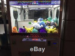 Arcade claw crane game machine