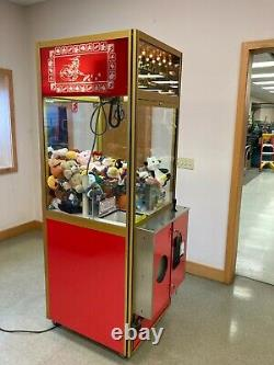 Smart Industries Clean Sweep crane claw machine loaded with toys